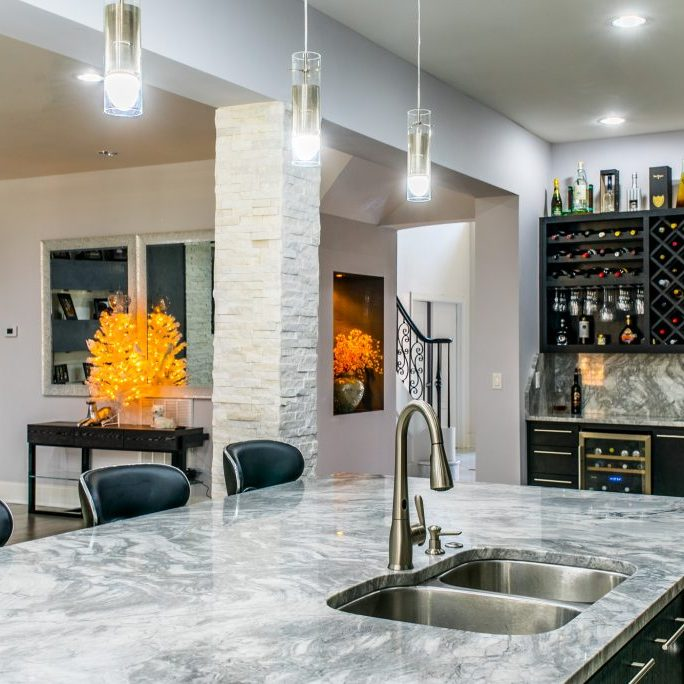 Marble kitchen island bar renovation by East Coast Granite of Asheville