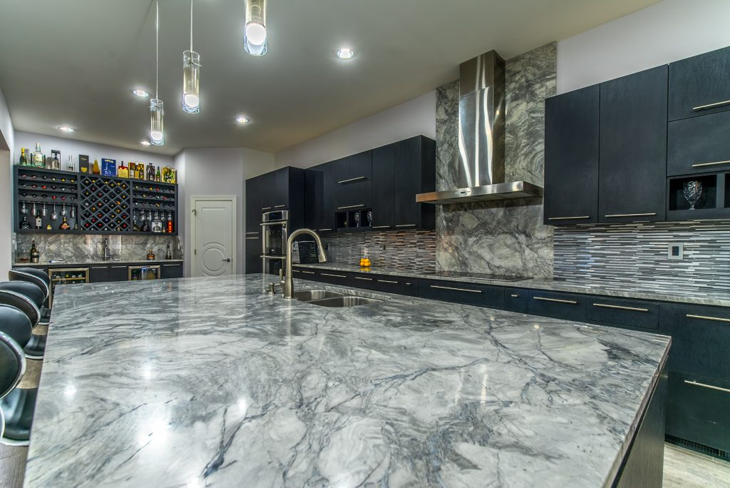 Marble kitchen island with sink installed by East Coast Granite of Asheville