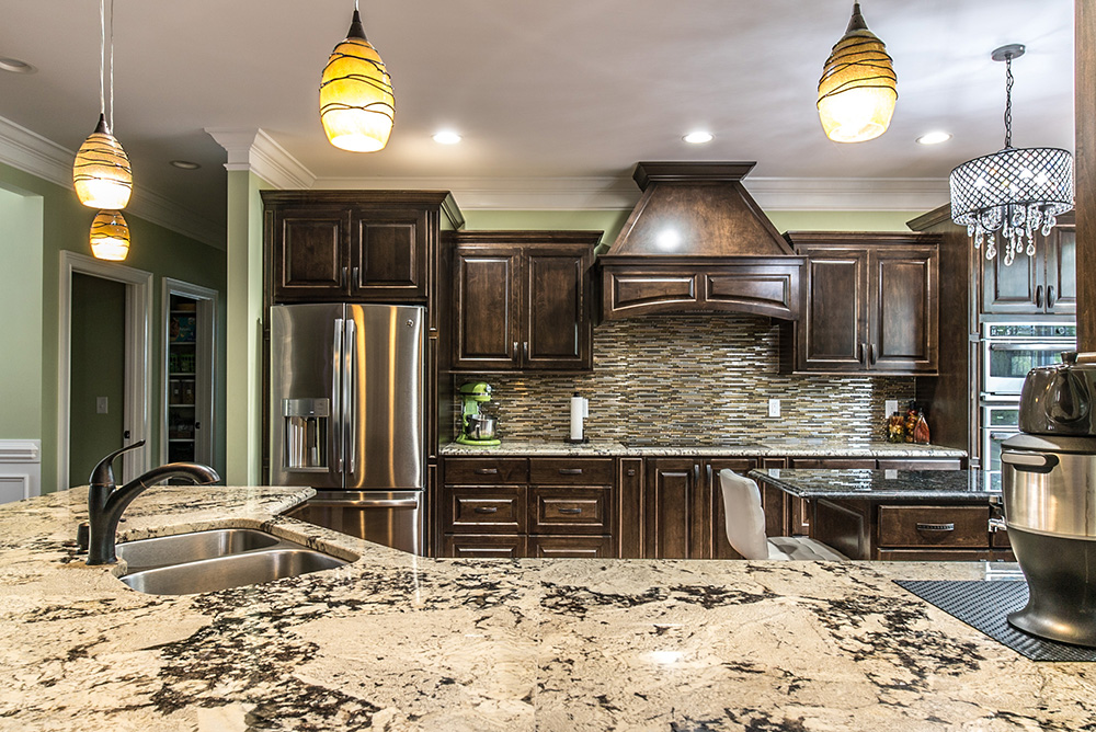 Delicatus White Granite Countertoputed Brown And Stainless Tile Backsplash Accented With Steel Liances