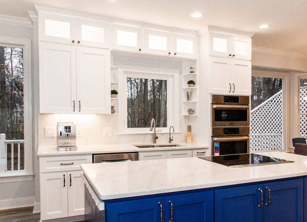 A spacious island topped with Helena quartz. To tie the space together we used the same material on the perimeter countertops and backsplash.