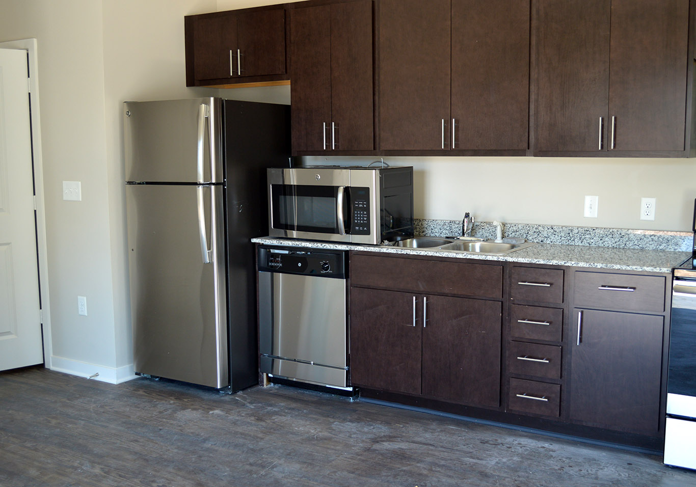 Lavish open kitchens with sprawling granite countertops really give the apartments at Main & Stone an amazing open concept